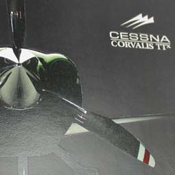 Concept brochure front cover, showing the spot varnish. The Corvalis aircraft is seen spotlighted in a dark hangar.