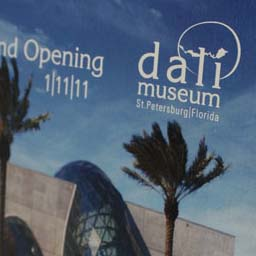 Direct mail concept Dali Museum. Exterior of mailer shows new logo and grand opening call to action.